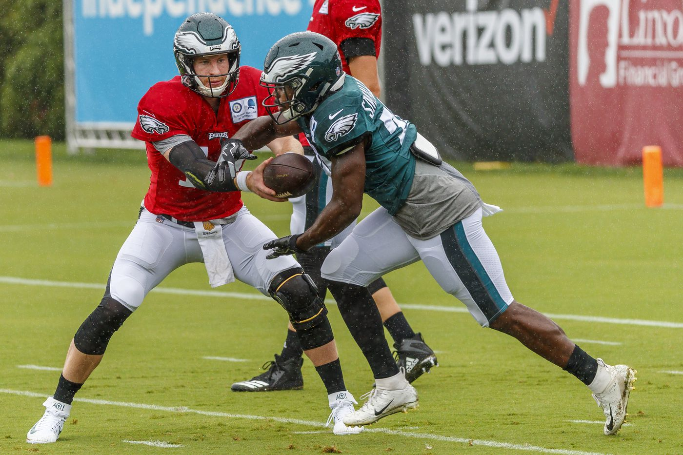8fa145d50 Quarterback Carson Wentz hands the ball off to running back Wendell  Smallwood during an offensive drill