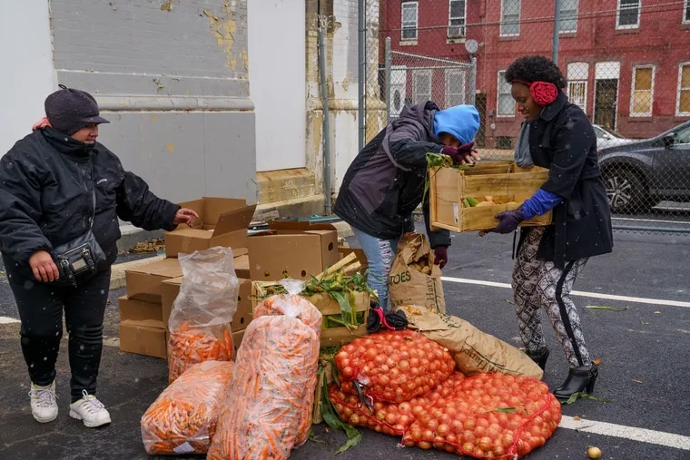 """Philabundance provides food throughout the region, including at so-called """"Fresh for All"""" distributions like the one in the parking lot of the Free Library of Philadelphia."""