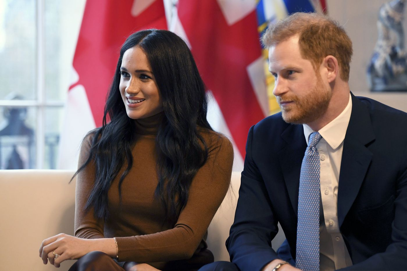 Prince Harry and Meghan to 'step back' as British royals, split time between U.K. and North America