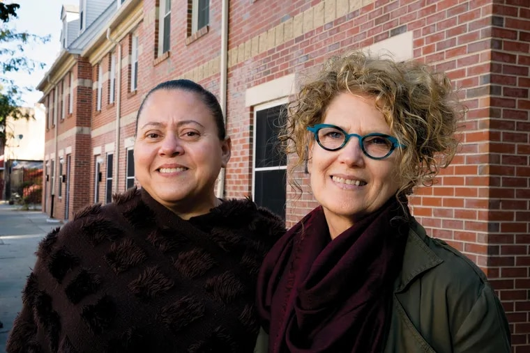Nora Lichtash, right, of the Philadelphia Coalition for Affordable Communities, wants an investigation of public land sales.