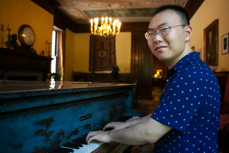 Pianist Tianxu An poses for a portrait inside the Bok Room at the Curtis Institute of Music in the Rittenhouse neighborhood of Philadelphia on Wednesday, July 17, 2019. An will perform later this week at the Mann Center with the Philadelphia Orchestra.