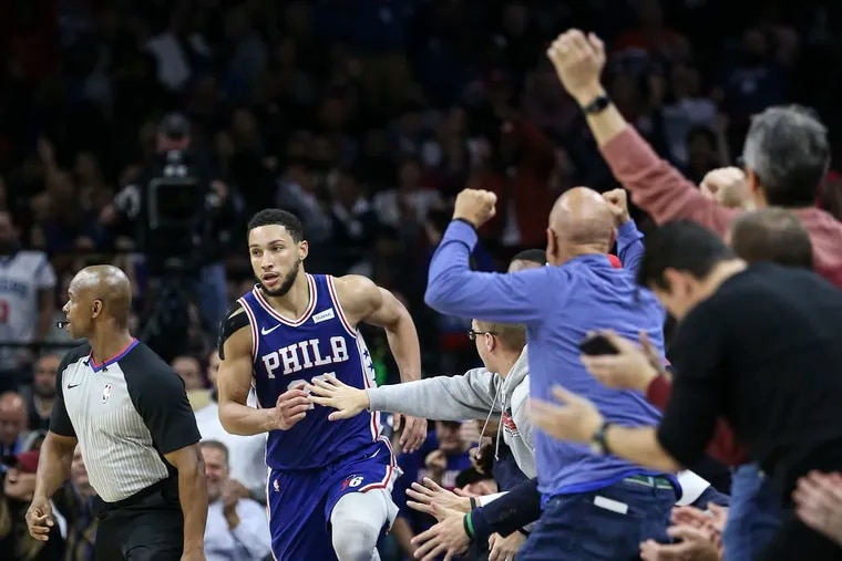 Sixers' Ben Simmons runs up the sideline as happy fans react after he made a basket in the fourth quarter against the Knicks.