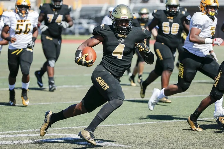 Neumann-Goretti halfback Leddie Brown (4) carried 16 times for 62 yards in Saturday night's 18-0 shutout of West Catholic.