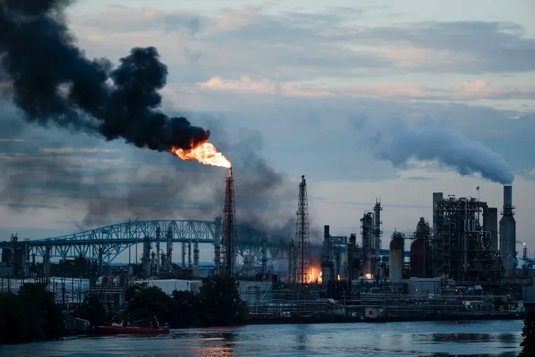 In this June 21, 2019 file photo, flames and smoke emerge from the Philadelphia Energy Solutions refining complex in Philadelphia. The 150-year-old oil refining complex that could processes 335,000 barrels of crude oil daily was one of the biggest stationary polluters in the city.
