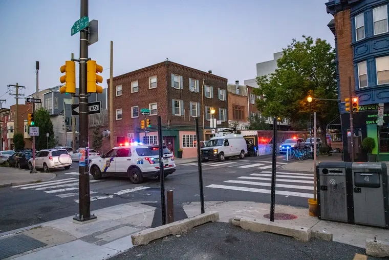 Philadelphia police block traffic at South Street and 15th Street as they guard the area around a fatal hit-and-run early Wednesday morning, July 28, 2021.