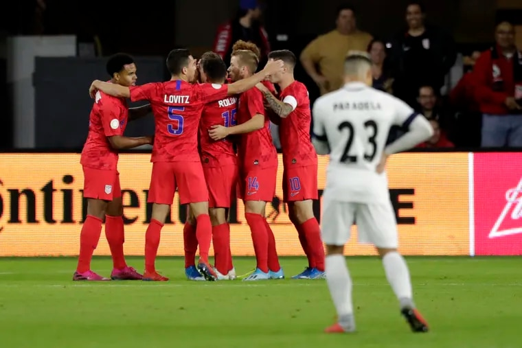 U.S players celebrate a goal by Weston McKennie (left) as Cuba's Luis Paradela (23) stands nearby during the first half of a CONCACAF Nations League soccer match Friday night.