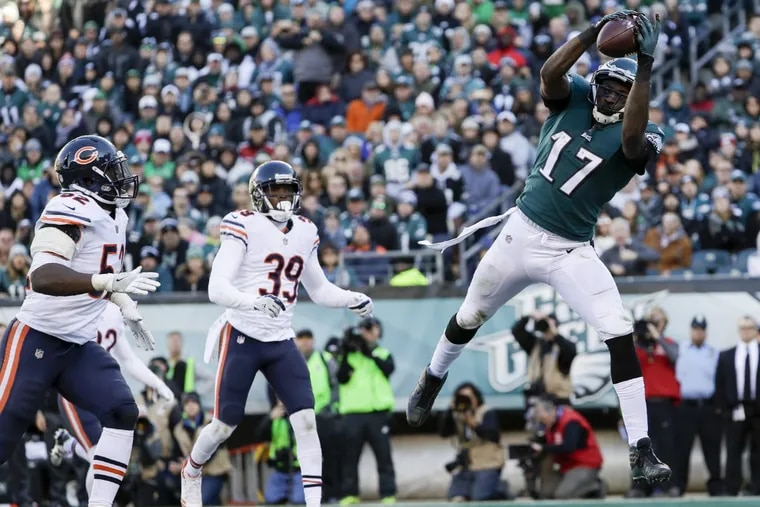 Eagles wide receiver Alshon Jeffery catches a late second-quarter touchdown past Chicago Bears inside linebacker Christian Jones (left) and free safety Eddie Jackson on Sunday, November 26, 2017 in Philadelphia. YONG KIM / Staff Photographer