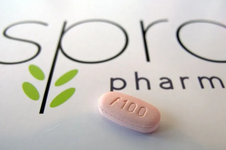 In this June 22, 2015, photo, a tablet of flibanserin sits on a brochure for Sprout Pharmaceuticals in the company's Raleigh, N.C., headquarters. (AP Photo/Allen G. Breed)