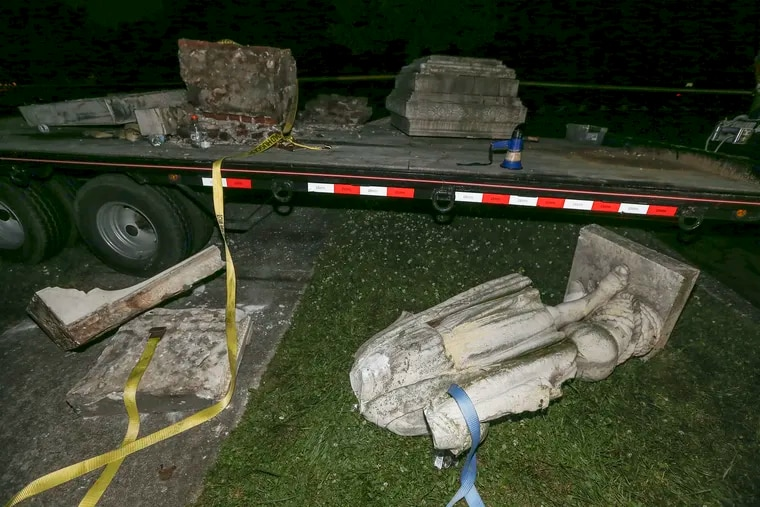 A headless statue of Christopher Columbus that was dismantled then knocked off the trailer in Farnham Park in Camden.