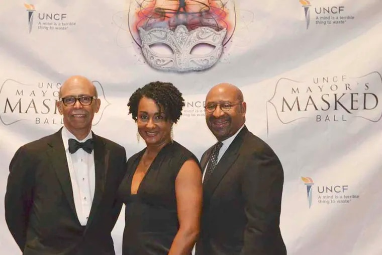 From left to right: Tom Lomax UNCF president stand with Lisa and Mayor Michael Nutter at the UNCF MayorÕs Ball on March 6,2015 at the Pennsylvania Convention Center. (Maggie Henry Corcoran / For the Philadelphia Inquirer)