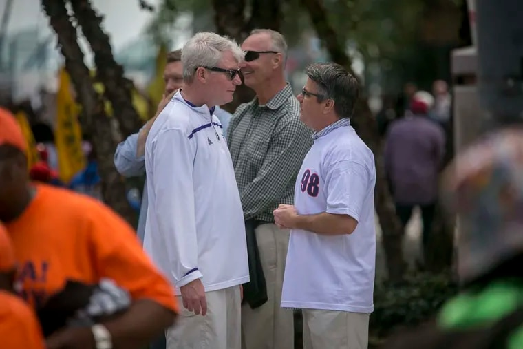 IBEW Local 98 labor leader John Dougherty (left) speaking with Councilman Bobby Henon during the 2016 Labor Day parade.