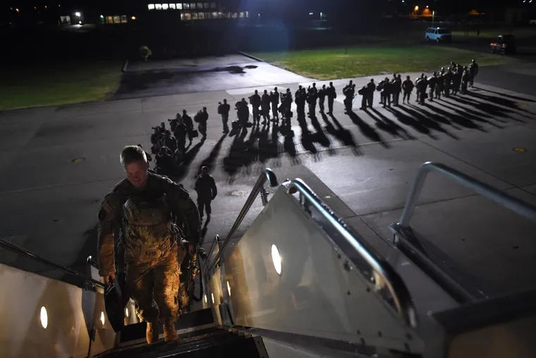 U.S. Army personnel board a plane for a deployment to Afghanistan from Fort Campbell, Ky., in November 2014.