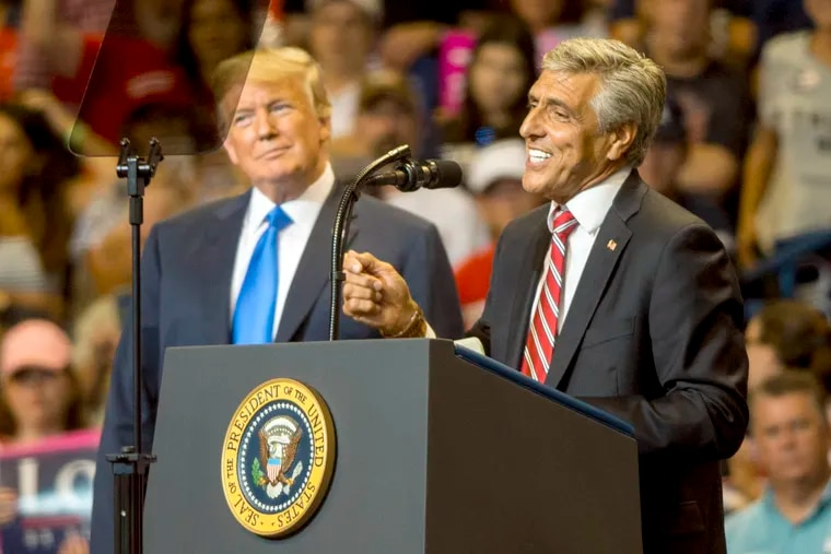 Former U.S. Rep. Lou Barletta (right), seen here at an August 2018 campaign rally in Wilkes-Barre with President Donald Trump (left), has a new political action committee to help Trump build a wall on the United States border with Mexico.