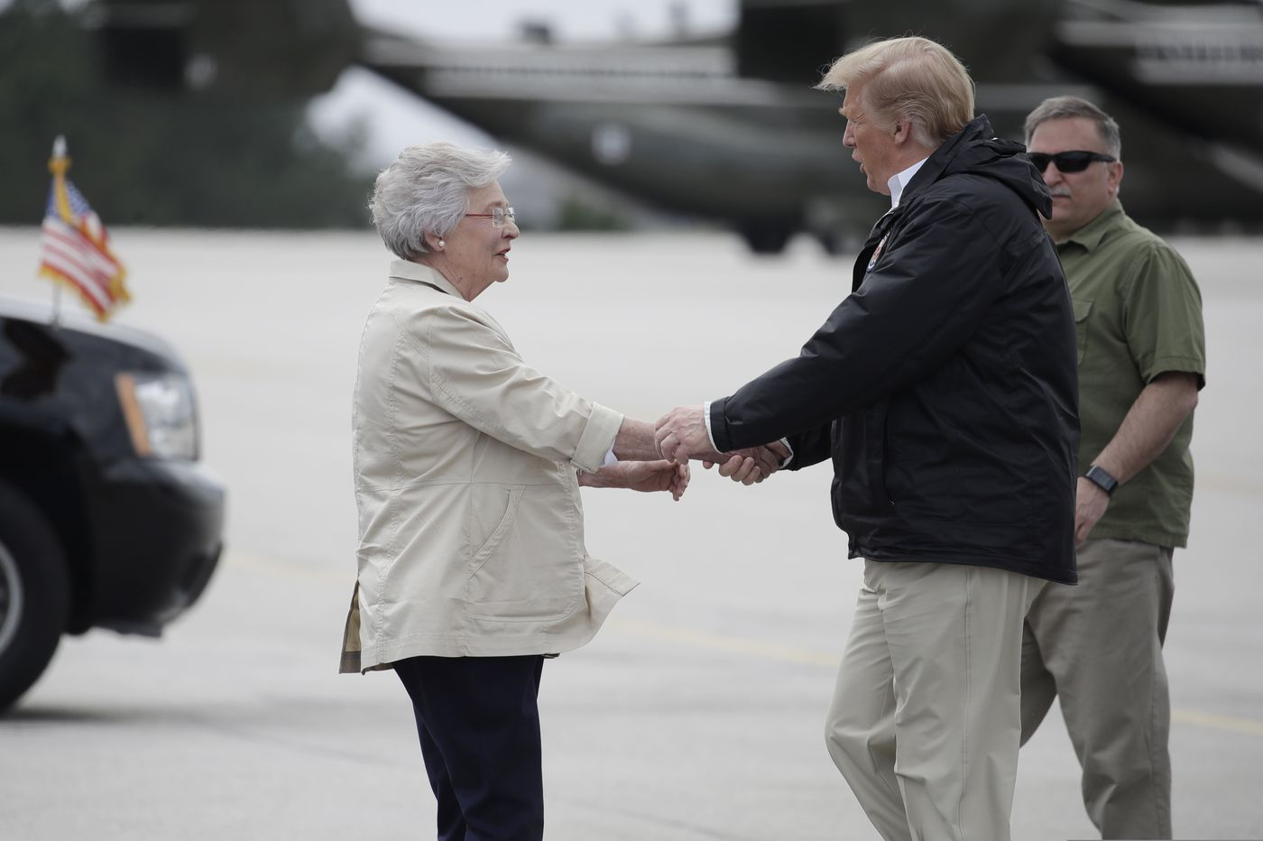 'He signed his Bible!' Trump gets hero's welcome in tornado-ravaged Alabama