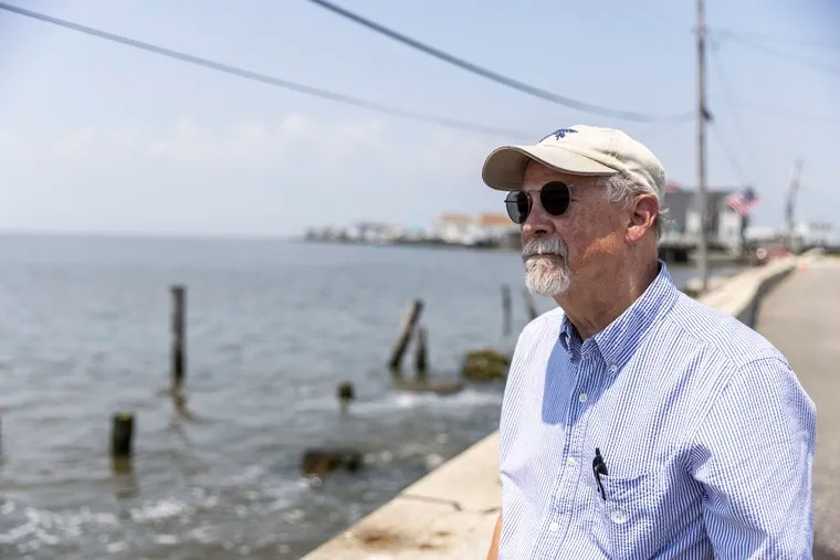 Hal Taylor, writer and illustrator, along the bulkhead that separates in Gandy's Beach in Downe Township, Cumberland County,  N.J.,  from Delaware Bay. His new book, 'The Book of Wedges - Tales from a Beach,' focuses mostly on vignettes about places and people along the Garden State's Delaware Bayshore.