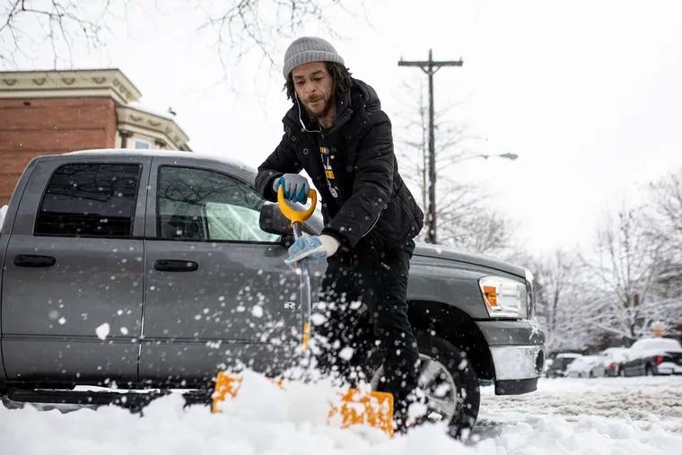 Mac Nickelz, 33, of West Philadelphia, shovels a fellow neighbors sidewalk along Larchwood Ave, in West Philadelphia, Pa., on Tuesday, Feb. 2, 2021. Nickelz lives along Larchwood Ave and has been shoveling homes since he was 13.