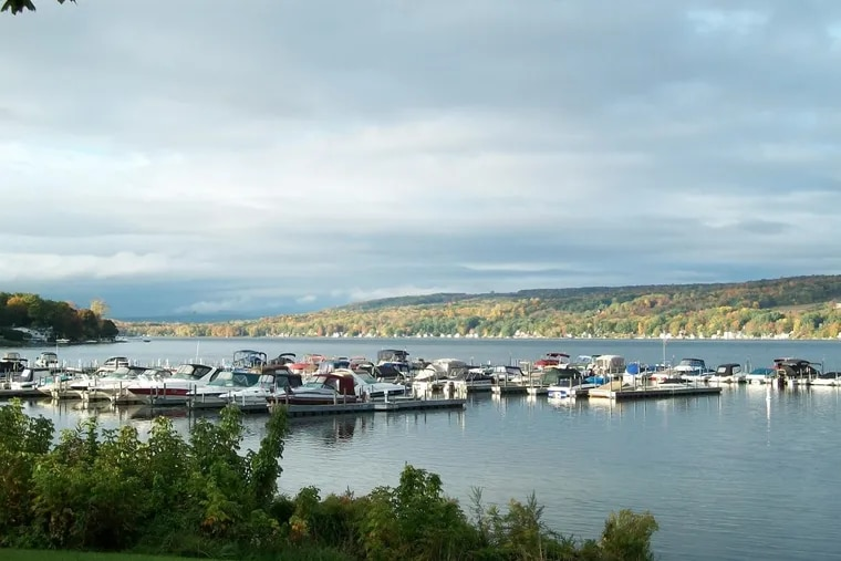 This undated image provided by Finger Lakes Tourism shows a view of boats on Keuka Lake in Red Jacket Park in Penn Yan, N.Y., in the Finger Lakes region. The area is known for wineries and scenic countryside around 11 long, narrow lakes in central New York, about 250 miles northwest of New York City. Fall is a popular time of year to visit thanks to the harvest season and autumn foliage.