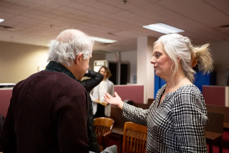City Commissioner Lisa Deeley speaks with Stephen Strahs, an advocate for hand-marked paper ballots, after a public meeting Wednesday.