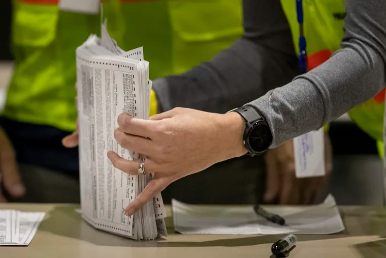 Workers count mail ballots in Philadelphia on Nov. 4, 2020.