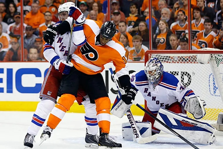 Wayne Simmonds goes after the puck against the Rangers' Marc Staal. (Yong Kim/Staff Photographer)
