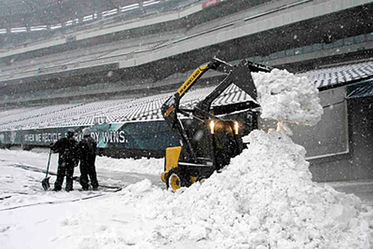 Inside Lincoln Financial Field on Sunday, crews moved mountains to get the field ready for some football. Their labor will pay off Tuesday night, when the Eagles and Vikings actually play. (Yong Kim/Staff)