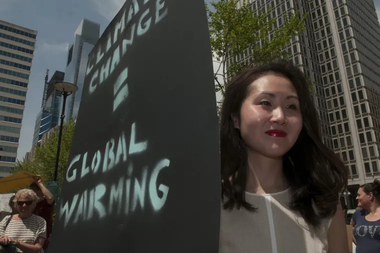 Lindy Li at an activists' rally near Philadelphia City Hall to protest the Trump administration's environmental policies in 2017.