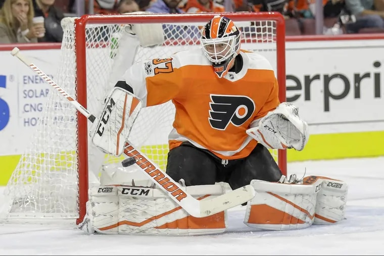 Flyers goalie Brian Elliott makes a save against the Arizona Coyotes during the second period.