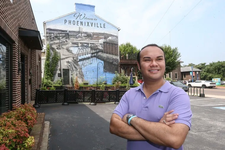 Phoenixville Mayor Peter Urscheler, poses in front of a mural in the borough on Thursday, August 16 , 2018.