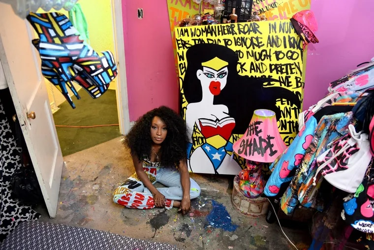 Mt. Airy designer Iris Bonner poses in her bedroom / studio Monday, August 31, 2105. Amber Rose got lots of attention wearing a jumpsuit from her line - Thesepinklips - to the VMAs. TOM GRALISH / Staff Photographer