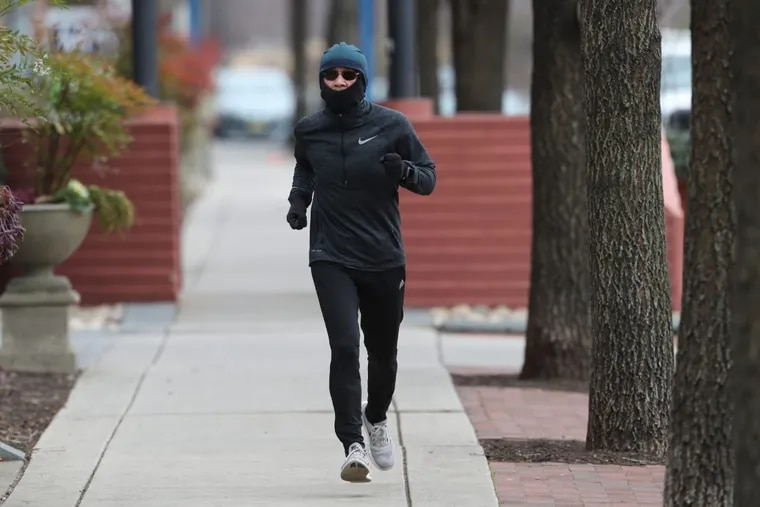 A bundled-up runner heads north on Columbus Boulevard on Friday.