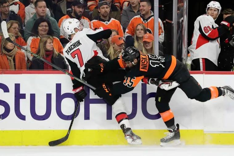 Flyers defenseman Matt Niskanen, here checking Ottawa left winger Brady Tkachuk earlier his season, has 14 points and a plus-13 rating in his last 16 games.