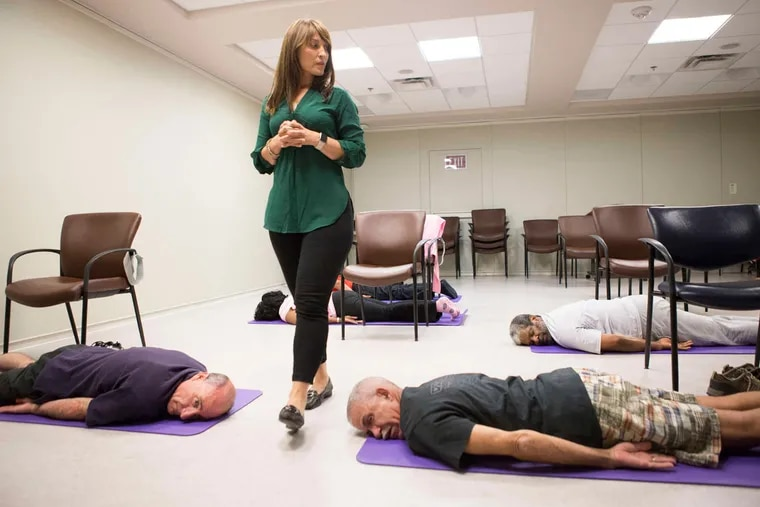 Yoga Teacher Lisa Rambaldo leads a Yoga class at the VA Medical Center, Thursday, July 14, 2016, in Philadelphia.