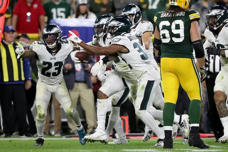 Philadelphia Eagles outside linebacker Nigel Bradham, second from left, celebrates with his teammates after intercepting a late 4th quarter pass against the Packers. Philadelphia Eagles win 34-27over the Green Bay Packers at Lambeau Field in Green Bay, WI on September 26, 2019.
