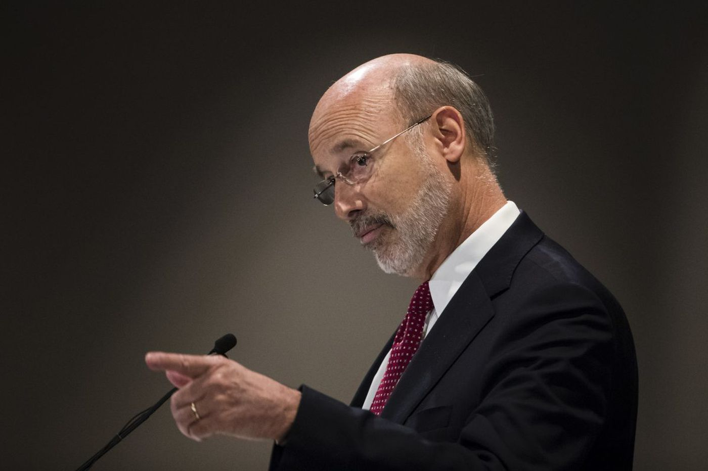 Wolf signs bills to balance Pa. budget with gambling and borrowing, hints of veto of education bill