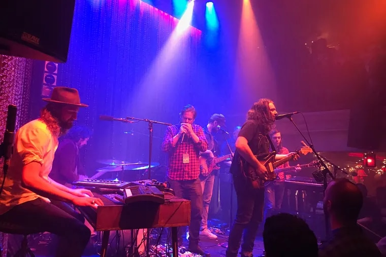 """Tim Heidecker of Tim & Eric sitting in with them on """"Arms Like Boulders"""" with the War on Drugs at Johnny Brenda's Wed., Dec. 19."""