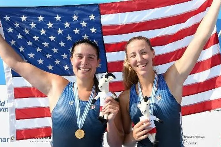 Alina Hagstrom (left) and Regina Salmons after winning the under-23 women's pair rowing world championship in Poland in July 2018.
