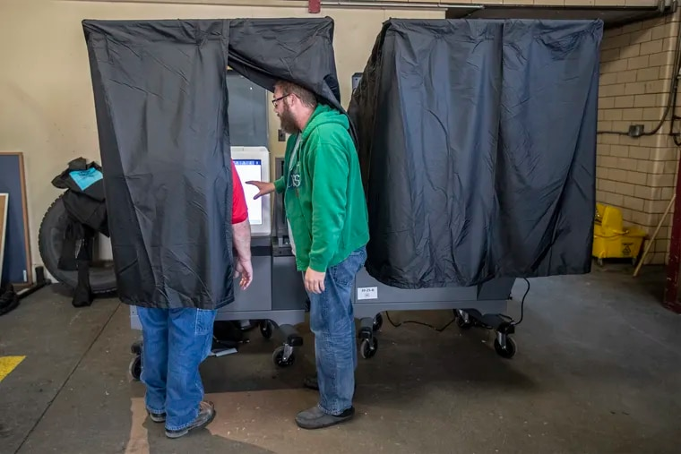 A Philadelphia voter receiving instruction on how to use new voting machines in the November 2019 municipal election.