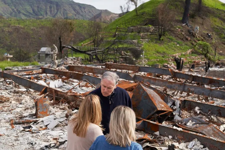 Democratic Washington Gov. Jay Inslee speaks in March with victims of last year's Woolsey wildfire in the Seminole Springs mobile home park west of Los Angeles.