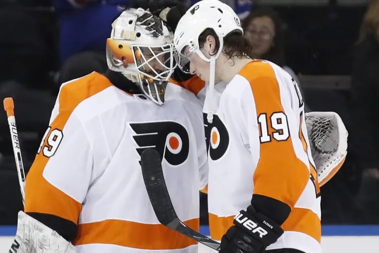 Philadelphia Flyers goalie Alex Lyon (left) gets congratulated by Nolan Patrick after the goalie's first NHL win Sunday at the New York Rangers.