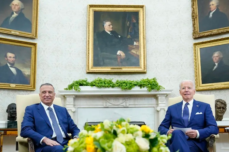 President Joe Biden (right) meets with Iraqi Prime Minister Mustafa al-Kadhimi in the Oval Office of the White House.