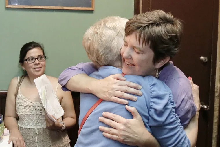 Margie Winters (right) was fired for being in a same-sex marriage. (ELIZABETH ROBERTSON / Staff Photographer)
