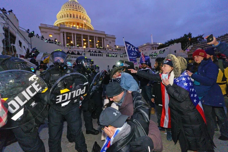 Police guard the Capitol Building after demonstrators were dispersed with tear gas after the building had been breached by insurrectionists on Wednesday.