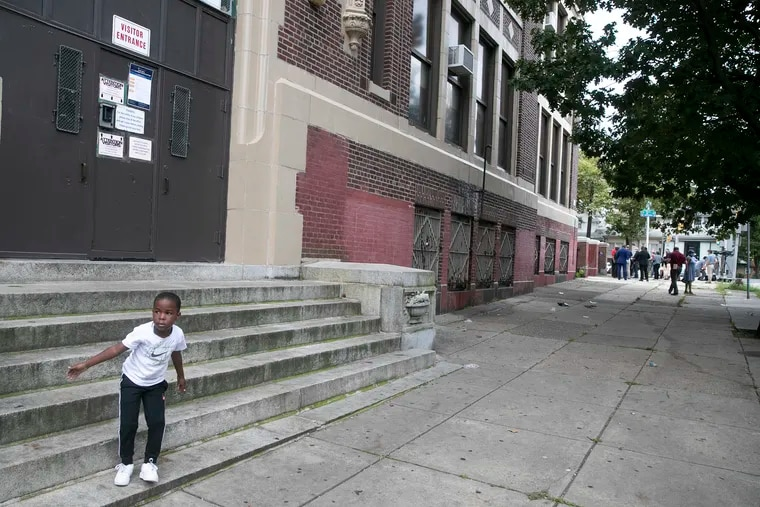 Philadelphia School District officials said Wednesday that some prekindergarteners through second graders can return to school buildings Feb. 22. In this September file photo, kindergartener Zahkir Satchell, who attends Lowell Elementary in Olney, is shown outside the locked doors of his school on his first day of school. COVID-19 has meant Philadelphia students have not set foot inside buildings for nearly a year.