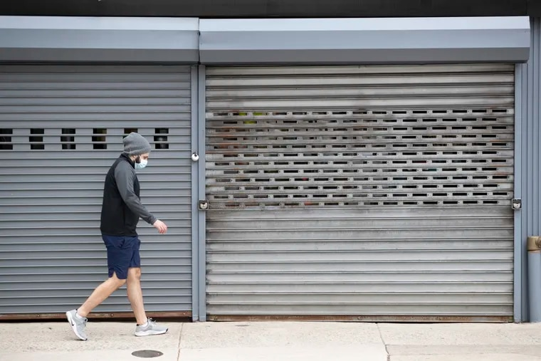 It is expected that Philadelphia will open much slower than the rest of Pennsylvania and the surrounding counties following the passing of the coronavirus. A pedestrian walks by closed stores on Eighth Street on April 25, 2020.