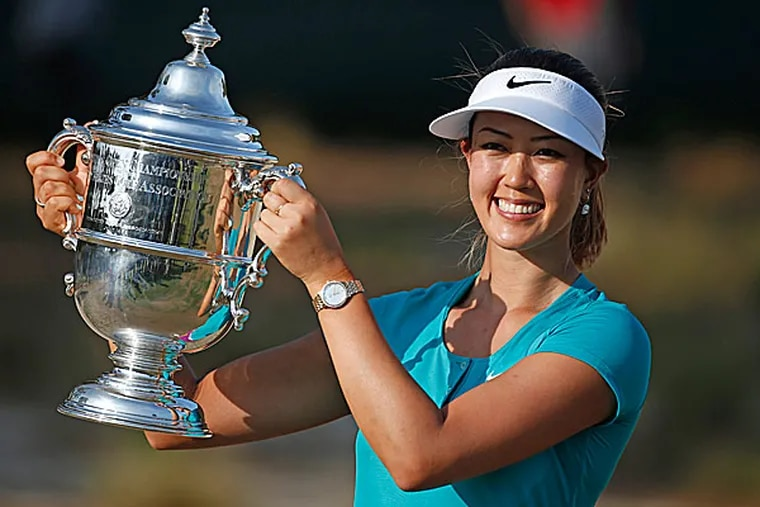 Michelle Wie holds the trophy after winning the U.S. Women's Open. (John Bazemore/AP)