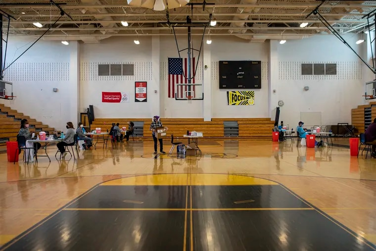The Philadelphia Department of Public Health and School District of Philadelphia had a COVID-19 vaccine clinic for school nurses in the school gym of Abraham Lincoln High School in Philadelphia on Friday, Jan. 22, 2021. District schools are set to begin limited in-person reopening in February.