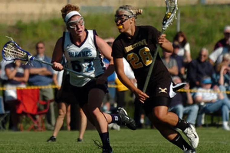 Moorestown's Alyssa Ogle scored seven goals, while Shawnee's Barb Previ (left) put up twoof her own in the sectional title game played at Shawnee.