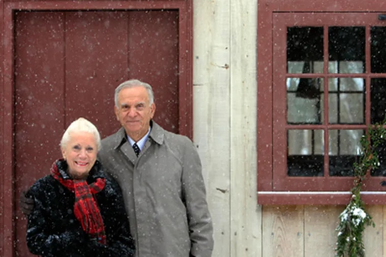 Patricia Salvatore and her husband Joseph Salvatore pose in front of an old building (Cox Hall) in the Cold Spring Village during snowfall. (Akira Suwa / Staff Photographer)