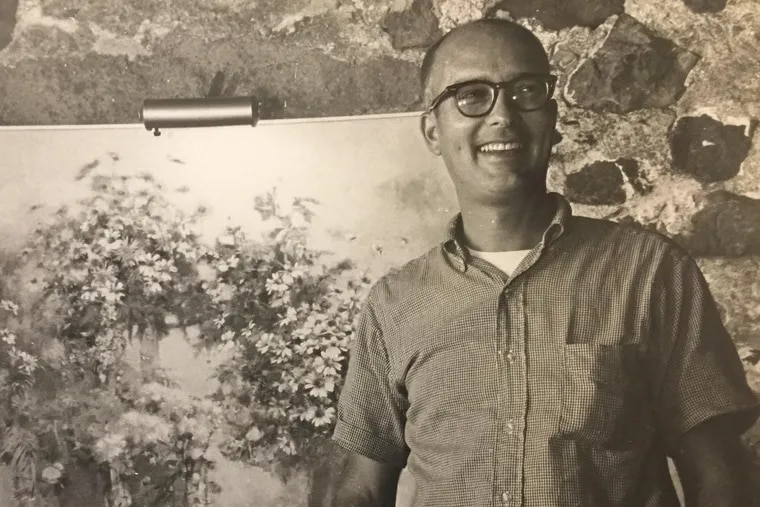 """Mr. Jamison stands in front of one of his paintings. """"People may think of [his painting] as realistic, but I think in terms of it being abstract,"""" Mr. Jamison told The Inquirer in 1998."""