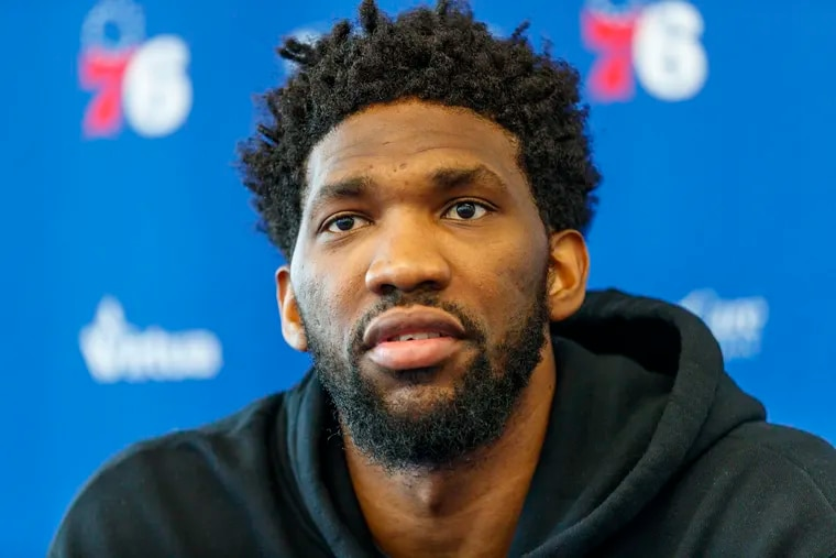 Joel Embiid answers questions from reporters on Monday.
